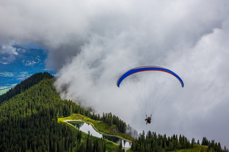 paraglide: Parachuting in high mountains Alps Austria Europe