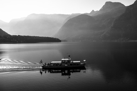 bw: Small boat on the foggy lake in b-w