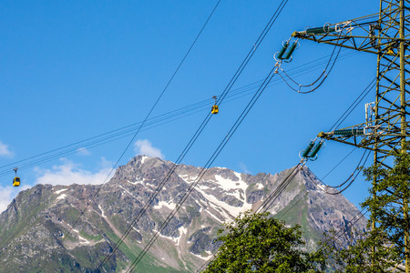 The wagoons of ski station and power lines Austria photo