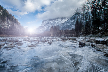 Sunset over the frozen stream in high mountains Alps Austria photo
