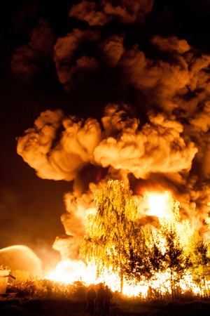 fire background: Big explosion with a lot of smoke and fire