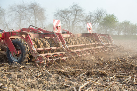 The harvester plowing and collecting on the field photo