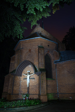 spook: The cross in the small chapel in the night Stock Photo