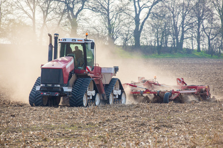 The tractor harvester working on the field photo