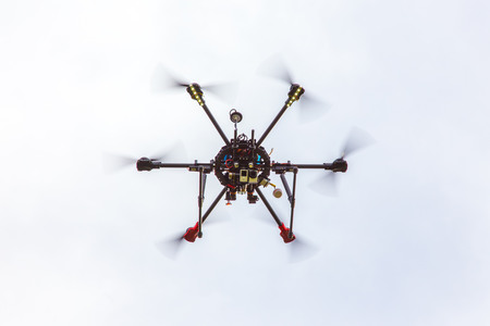 The small dron hexcopter flying over the field