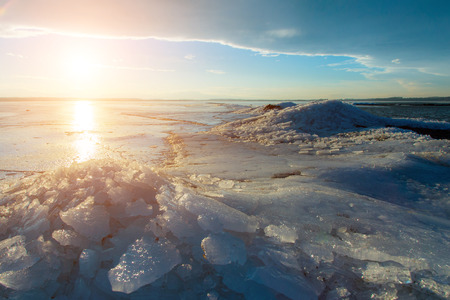 Beautiful sunset over the frozen lake in winter photo