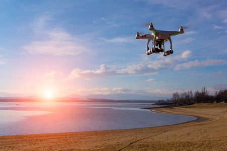 drone: Modern drone watching the beautiful sunset