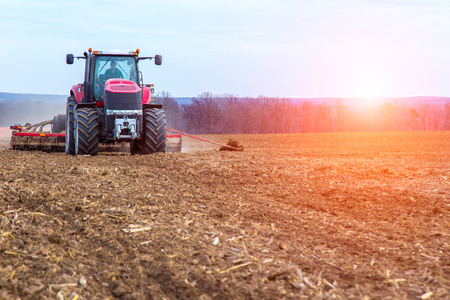 crop farming: The tractor working on the large field
