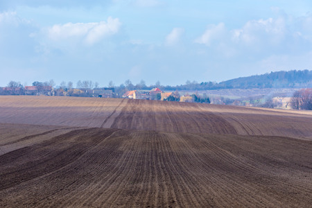 plough machine: Large field ready for sowing and plowing action in the spring season