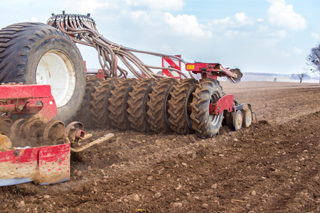 plough machine: Sowing and plowing action in the spring season Stock Photo