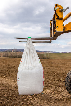 The bags with fertilizers inside used in fertilizing action in spring time