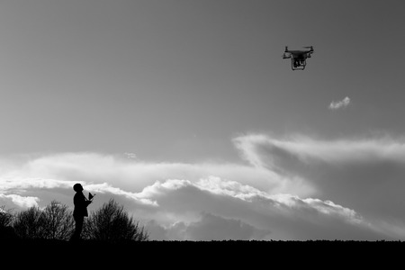 One person controlling the flight of the small drone