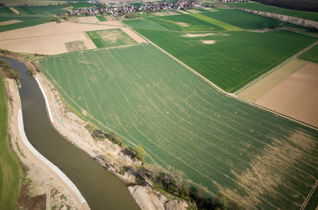 Aerial view of the large green field in spring season photo