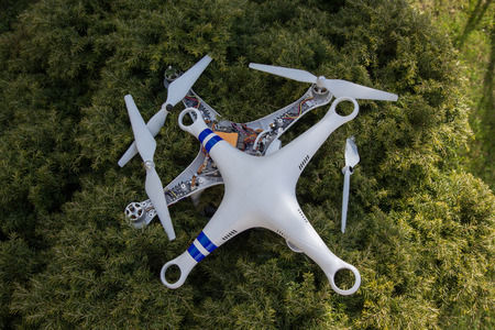 misfortune: Small damaged drone after the bad accident
