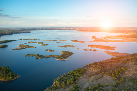 Aerial view on a sunset over the lake photo