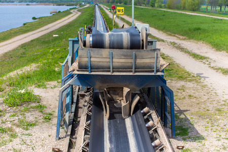 conveyors: The conveyor of the sand at the sand mine Stock Photo