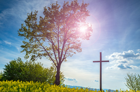 wooden cross: Beautiful sunset over the cross on the field