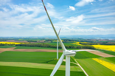 colza: Aerial view on the windmills on the yellow colza field Stock Photo