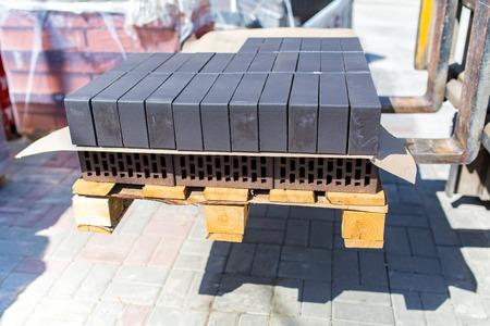 porous brick: Many grey bricks on a small palette