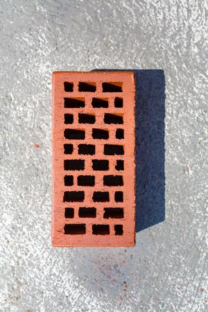 porous brick: Close view on the single red brick Stock Photo