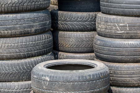 dumped: Close view on the stack of old tires