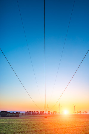 powerline: Beautiful sunset over the powerline on the field