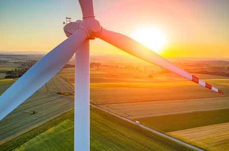 electricity generator: Beautiful sunset above the windmills on the field