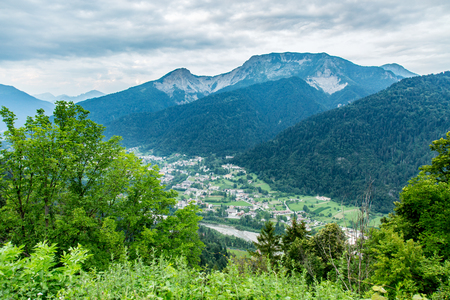 green land: Aerial view on the small village in mountains