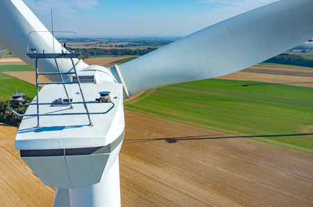 sun energy: Aerial view on the windmills on the field