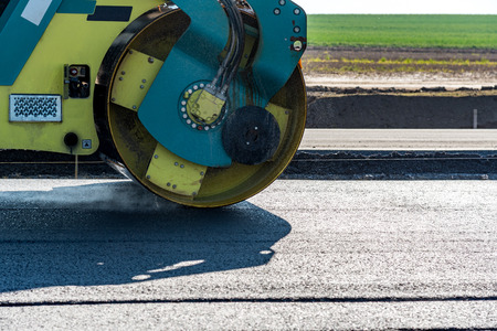 blacktopping: Road rollers building the new asphalt road