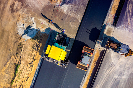 Aerial view on the new asphalt road under construction