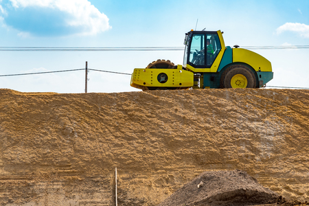 steam roller: Large view on the compactor working on the new road construction site Stock Photo