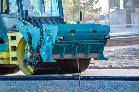 construction vibroroller: Close view on the road roller working on the new road construction site