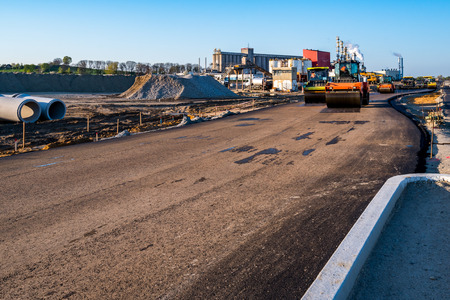 compacting: Large view on the road rollers working on the new road construction site Editorial