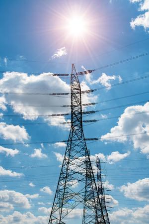 megawatt: Beautiful sunset above the modern high powerlines Stock Photo