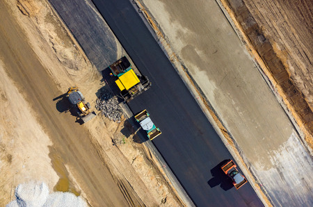 vibroroller: Aerial view on the road rollers working on the new road construction site