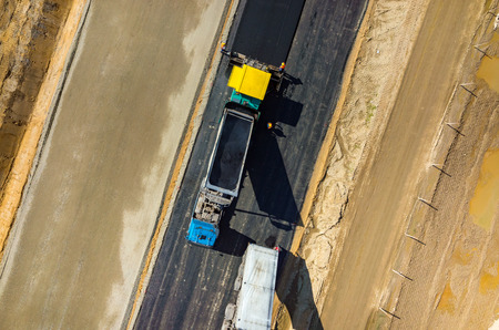 construction vibroroller: Aerial view on the road rollers working on the new road construction site