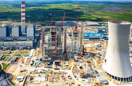 Aerial view on the construction site of the new modern power station Editorial