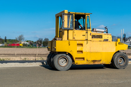 steam roller: Close view on the road roller working on the new road construction site