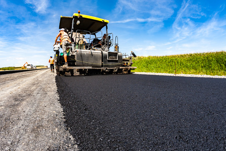 Large view on the road rollers working on the new road construction site Standard-Bild