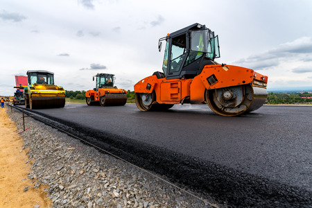 construction vibroroller: Large view on the road rollers working on the new road construction site Stock Photo