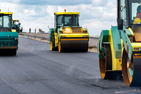 construction vibroroller: Close view on the road rollers working on the new road construction site Stock Photo