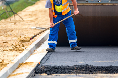 vibration machine: Close view on the workers and the asphalting machines