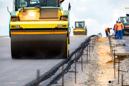 vibroroller: Close view on the road rollers working on the new road construction site Stock Photo
