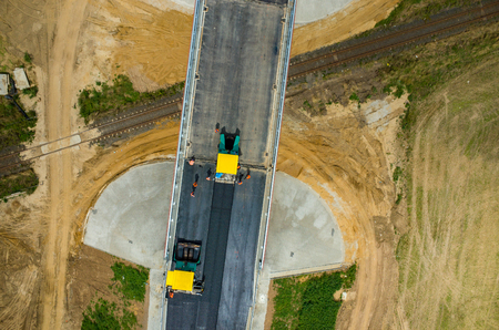 asphalting: Aerial view on the new asphalt road under construction