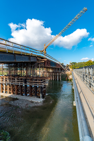 Large view on the bridge over the river under construction