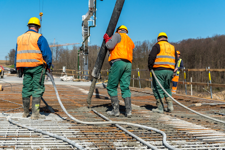 Close view on the concrete pouring on the construction site Stock Photo - 76819525