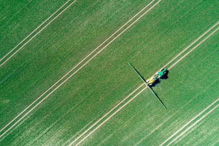 Aerial view on the spraying machine on the field 免版税图像