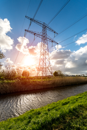 Beautiful sunset above the modern high powerlines Stock Photo