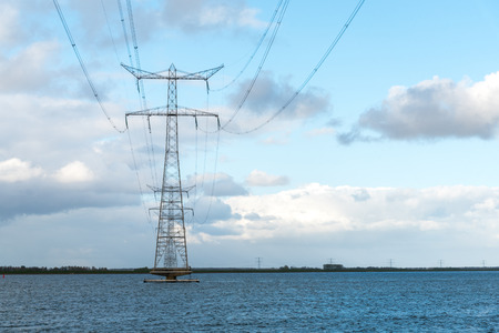 Large view on the modern high powerlines in the ocean Stock Photo